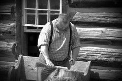Villager (Элвин Ваутерсе) Tags: farmer villager blackwhite grey man human person work working skylinestudio nikon d40 elwinw canada blackcreek creek ontario male fat big overweight wood house home strong strength can