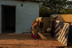 Chandelao. Rajasthan. India (Tito Dalmau) Tags: woman clean yard house light morning bed chandelao rajasthan india