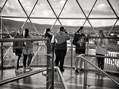 2018-10-26_11-39-53 (GLKPhotos) Tags: people sightseeing metal structure dome glass architecture construction skyline candid street town belfast cityofbelfast city cityscape citycentre northernireland tones tonalcontrast contrast blackandwhite mono monochrome victoriacentre shoppingcentre railings stairway