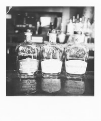 untitled-3 (dvlmnkillatron) Tags: film polaroid analog polaroidoriginals mint instantfilm slr670s sevensaints bw whiskey champaign reflection bokeh