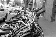 Row of Bikes (bac1967) Tags: kiev contax kiev4 kodak kodaktrix kodaktrixfilm film 135film 35mmfilm rodinal rodinal150 blackandwhite blackandwhitefilm blackwhite bw monotone monochrome panfilm adonal ro9 r09 oregon pnw pacificnorthwest rangefinder rangefindercamera soviet russian fsucamera jupiter8 jupiter8lens bike bikes bikesonfilm springfield springfieldor
