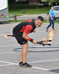 Daniel Craig of The Street Circus at the 2018 Waterloo Busker Carnival (Ryan Hodnett) Tags: 2018waterloobuskercarnival waterloobuskercarnival waterloo ontario canada thestreetcircus danielcraig busker busking streetperformer juggling juggler torches fire jugglingtorches