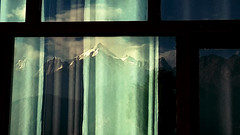 The Reflection (rupak.here) Tags: curtain window mountain reflection glass pane