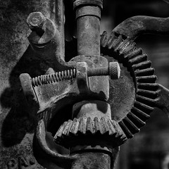 Spring With Gears (arbyreed) Tags: arbyreed monochrome bw blackandwhite machine mechanism spring gear old forgotten abandoned rusted rusty squareformat legends legendsmotorcycleemporium sidecarcafe motorcycles vintagemotorcycles indianmotorcycles