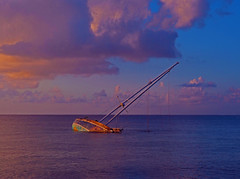 fading sun... an evening stroll on the malecon (oceanzam) Tags: seascape beach cozumel mexico malecon sol dusk color colorful scenic travel nature sail clouds blue azul sailboat