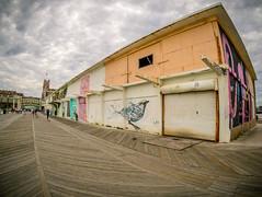 art wall  (Asbury Park Boardwalk, NJ) (Steve Stanger) Tags: asburypark asburyparkboardwalk nj ap boardwalk firstdayoffall fall beach shore beachscape jerseyshore newjersey art olympus9mmf80fisheyebodycaplens bodycaplens 9mmfisheye olympus olympusomdem10markii cloudy clouds