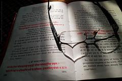 FALLING IN LOVE WITH A BOOK (GOPAN G. NAIR [ GOPS Creativ ]) Tags: gopsorg gopangnair gops gopsphotography gopan photography creativ gita bhagavat geetha geeta krishna love specs message
