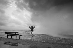 Run! (tzevang.com) Tags: cloud cyclone bw greece running sea waves top20greece