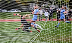 Over the top (stephencharlesjames) Tags: womens sport college sports soccer ball action net ncaa middlebury vermont tufts