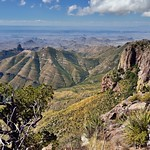 Blue Skies and Clouds Above the Peaks and Mountainsides of the Chisos Mountains (Big Bend National Park) thumbnail