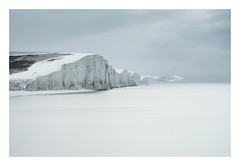 Snow-covered Seven Sisters (Edd Allen) Tags: sea seaside seascape sky atmosphere atmospheric buclic serene uk england britain nikon d810 clouds sunrise eastsussex southeast wave storm tide nikkor70200mm landscapephotographeroftheyear newhaven newhavenharbour winter abstract water wind lpoty sevensisters snow longexposure