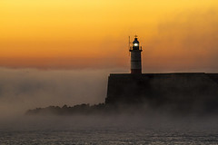 fog rolls in 1 (photoautomotive) Tags: newhaven eastsussex england uk europe lighthouse light fog silhouette sea englishchannel ripples sunrise sussex pier breakwater sky