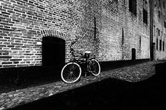 Lonesome (Jan Wildeboer) Tags: monochrome white bike black f80 12mm samyang