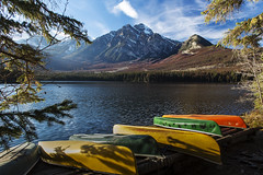 Pyramid Lake Canoes (Terry L Richmond) Tags: water lake mountain boat river reflection nature landscape tree sky outdoor travel wilderness noperson sitting yellow green leaf small nationalpark canoe loch front wood bank floating outdoors scenic recreation mountscenery colorful large dawn wooden mountainrange tourism jasper canada alberta pyramidlake