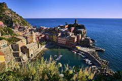 The Colorful Gem of Cinque Terre (abhishek.verma55) Tags: vernazza cinqueterre village colourful colour vacation ©abhishekverma landscape landscapes hike italy colorful houses bay architecture travel europe blue boat italianriviera holiday italian famous sea seascape seaside seashore shore shoreline mediterranean seascapelovers coast flickr photography vivid vibrant colors hills buildings building scenic spezia scenery scene view topview outdoor outdoors colours boldcolours rock wanderlust dreamvacation beautiful beauty bluesky