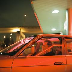 Midnight meeting: Ivan (belousovph) Tags: portra400 mediumformat analog film portra kodak 120 zenzanon bronica light russia minimal atmospheric sky square auto road car trailer oldschool classic neon building sign portrait