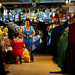 Two women stocking their market stall in Warorot Market in Chiang Mai, Thailand