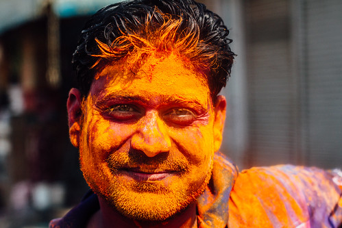 Portrait of Man in Orange Gulal for Holi