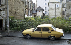 Abandoned car (Manuel Goncalves) Tags: car road abandoned bucharest romania nikonn90s kodakportra400 35mmfilm epsonv500scanner