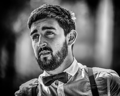 See the bowtie? I wear it and I don't care. That's why it's cool.~Steven Moffat~ (Lorrainemorris) Tags: streetportrait gmaster contrast lightroom blackandwhite monochrome dapper smart sunnyday beard bowtie streetphotography streetphotographie man zeiss 70200 sonyilce7rm2 lorrainemorris sony7rm2