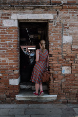 Curiosity (evans.photo) Tags: venice italy people colour woman doorway