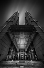 Pillars Of Strength (Alec Lux) Tags: bw clarke quay singapore architecture art asia black blackandwhite blackandwhitephotography building buildings centre city clouds design exterior facade fine fineart geometric geometry hospital lines longexposure longexposurephotography minimal minimalism modern orient oriental outdoor outside sky skyscraper structure trails urban white