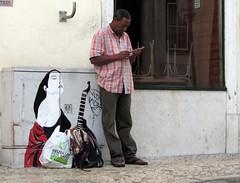 street scene in lisbon (lualba) Tags: strassenkunst graffiti musician man woman street lisbon lisboa lissabon portugal