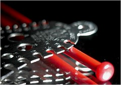 9 Needle, 14 Hole ! (jesse1dog) Tags: macromondays measurement bell knittinggauge gauge metal steel numbers numerals needle red reflection mirror artifacts gm1 pentaxauto110 70mm extensiontube tabletop neonlighting slots holes bokah vintageprime