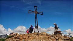 The summit cross of the Speikboden (2,517 m high) in the Tauferer Ahrntal in South Tyrol (Ostseetroll) Tags: geo:lat=4691793440 geo:lon=1189056300 geotagged ita italien luttach speikboden südtirol ahrntal gipfelkreuz zillertaler alpen gipfel peak summit cross alps olympus em5markii