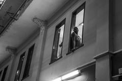 Cigar Roller on Break at the Cohiba Factory - Havana, Cuba (ChrisGoldNY) Tags: chrisgoldphoto chrisgoldny chrisgoldberg cuba cuban caribbean latinamerica licensing forsale cubano bookcover albumcover sony sonyimages sonya7rii sonyalpha havana habana lahavana lahabana cohiba cohibafactory blackandwhite bw candid windows factory afrocuban man men people