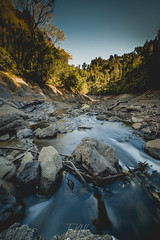 Canyon stillness (SunThroughEyelids) Tags: photography camera 2870mm travelling travel newzealand nz north vsco beautiful nature nathew canyon yellow orange fullframe a7iii a7ii apha sony longexposure lake water