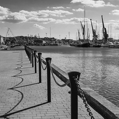 Shadows (2 of 3) (+Pattycake+) Tags: cranes wherry quayside water panasonic boats angler suffolk clouds 13sept18 shadows urban ipswich paving people road marina sky town bw dmcgm1 chains street