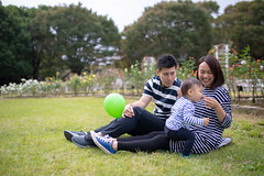 Young family having lunch in public park (Apricot Cafe) Tags: img113265 asia asianandindianethnicities japan japaneseethnicity millennialgeneration shibuyaward sigma35mmf14dghsmart tokyojapan yoyogipark athlete autumn baby babyboys balloon birthday bonding boys candid capitalcities carefree casualclothing colorimage copyspace day eating family father foodanddrink fulllength happiness lawn leisureactivity lifestyles lunch men midadult mother nature outdoors people photography picnic publicpark realpeople sandwich shorthair sitting smiling son standing straighthair threepeople togerherness togetherness toothysmile walking women youngadult
