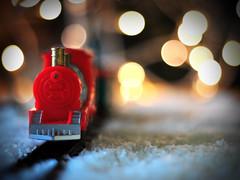 Toy Train under Christmas Tree (Martyn.Hayes) Tags: christmas stilllife bokeh softfocus closeup decoration xmas seasonal festive joy happy tree snow christmaslights fairylightstrain toy railway tracks fakesnow confetti fairylights red steamtrain