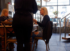jeans (watcher330) Tags: carmarthen women cafe table jeans holes