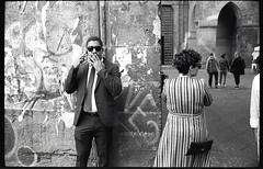 (Experience And Innocence Bleed Inside Me) (Robbie McIntosh) Tags: leicamp leica mp rangefinder streetphotography 35mm film pellicola analog analogue negative leicam summilux analogico leicasummilux35mmf14i blackandwhite bw biancoenero bn monochrome argentique summilux35mmf14i autaut dyi selfdeveloped filmisnotdead kodaktrix400 kodak trix d76 kodakd76 leicasummilux35mmf14 summilux35mmf14preasph street carabinieri eyecontact shadow man woman