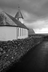 Vidareidi - The Faroe Islands (virtualwayfarer) Tags: viðareiði northernisles faroeislands fo nordic nordics kingdomofdenmark sea seascape landscape sunset goldenhour mist lastlight seaside ocean church seasidechurch chapel misty damp fjord fjords seamist lowclouds cloudy overcast weather dramaticweather roadtrip visitfaroeislands explore exploring viðareiðikirkja kirkja islands island village wanderlust volcanic sonyalpha a7rii travelphotography travelphotographer natural nature cliff cliffs senic alexberger