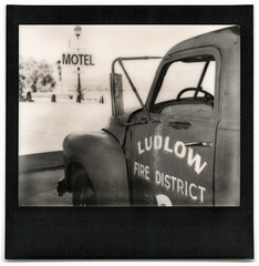 motel fire / route 66. ludlow, ca. 2014. (eyetwist) Tags: eyetwistkevinballuff eyetwist route66 sign ludlow motel firedistrict firetruck mojavedesert impossibleproject polaroid spectra pro impossible bw image blackwhite polaroidspectrapro impossiblebwspectra project pz black white mono monochrome sooc film analog analogue ishootfilm instant integral mojave desert america americana faded sunburned decayed derelict american west route 66 motherroad vacancy signage signgeeks type typography typographic americantypology california arid dry hot rusty fire district truck i40 interstate 40 abandoned trucks trucker wheels roidweek2018 blackframe
