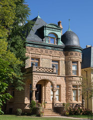 The Laura and George Peckham Miller House was built in 1887 in Milwaukee, Wisconsin.  The architect was August Fielder of Chicago. (thstrand) Tags: entrance rosecoloredstone pinkstone slateroof mansions mansion 1880s 1887 19thcentury abelmanaquartzite american architecturalstyles architecture augustfielder brick cutstone dwelling elaborate exterior firstwardtrianglehistoricdistrict front georgepeckhammiller historicsite history home house laurachapmanmiller masonrywalls midwest midwestern milwaukee motifs nationalregisterofhistoricplaces nobody queenanne residence romanesquemotif tourism touristattraction traveldestination traveldestinations turret variety various victorian wi wealth wisconsin
