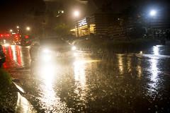 0921 Car drives through heavy rain near the Denton Square