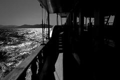 Beautiful sea (chrisnormandale) Tags: boat sea black white ocean sun glistenning turkey summer travel transport holiday trip silhouettes street photography ricoh grd4 wwwchrisnormandalecom
