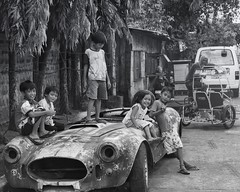 Nice Toy (Beegee49) Tags: street children playing posing smiling car sports shelby 427 bacolod city philippines