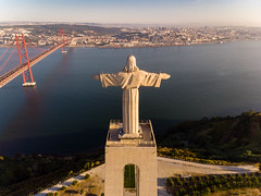 Aerial view from behind of the Cristo Rei statue in Almada, looking over the Tajo river with Ponte 25 de Abril bridge (verchmarco) Tags: locationindependent dnx lisbon aerialaesthetics luftbildaufnahme aerial portugal dji lisboa reiseblogger luftaufnahme digitalnomad reisen travel lissabon mavicair aerialphotography noperson keineperson water wasser reise architecture diearchitektur sky himmel sunset sonnenuntergang outdoors drausen church kirche city stadt cross kreuz religion dawn dämmerung landscape landschaft river fluss light licht bridge brücke seashore strand daylight tageslicht sea meer evening abend path harbour brown morning perfectmatch national hiking woods sunny fog