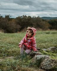 Itty Bitty Pretty One (HelloI'mJulia.) Tags: portrait portraits child childhood nature family fujixt2 fuji fujifeed fujifilmxt2 focus grass field virginia 35mm 35mmf14 girl sky farm