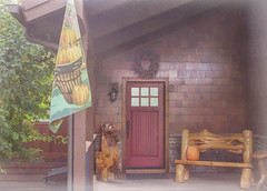 Home Sweet Mountain Home (Karon Elliott Edleson) Tags: cabin mountainhome frontporch autumn fall bigbearlakeca welcome bench door bears escape makemesmile topaz