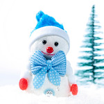 Snowman in the snow with a Christmas tree thumbnail
