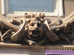 Mustache Man Gargoyle New Victory Theater 0589 (Brechtbug) Tags: mustache man gargoyle new victory theater above entrance way building facade near 7th avenue west 42nd street nyc 09152018 september york city midtown manhattan 2018 gargoyles portraits monster portrait monsters creature faces spooky art architecture sculpture keystone mask brownstone brown stone capital sneer sneering calm placid leaf men