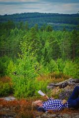 Swedish summer (Klas-Herman Lundgren) Tags: gagnef gimmen midsummer sverige sweden dalarna dalaskogarna firande forest midsommar skog sommar summer green reading man book nature travel vacation uppsala