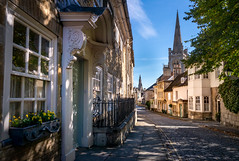 Stamford Lincolnshire. (Johnners61) Tags: stamford lincolnshire uk england britain town city street spire spires church georgian old historic history facade door doorway decorative leadinglines dappled sun sunlight cobbled cobbledstreet cobbles lane samsung nx mini wideangle 24mm