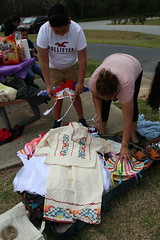 Abila, right, lays out a costume with her grandson Christian Canales, left. All of Abila's costumes are handmade in Mexico.